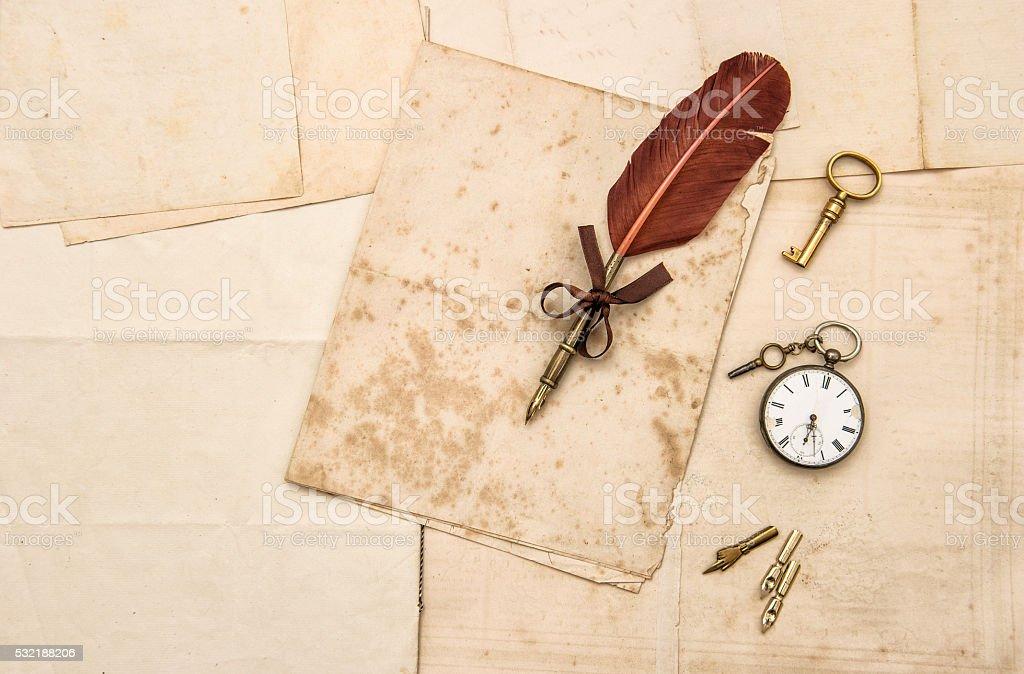 Vintage papers and ink pen. Nostalgic sentimental background stock photo