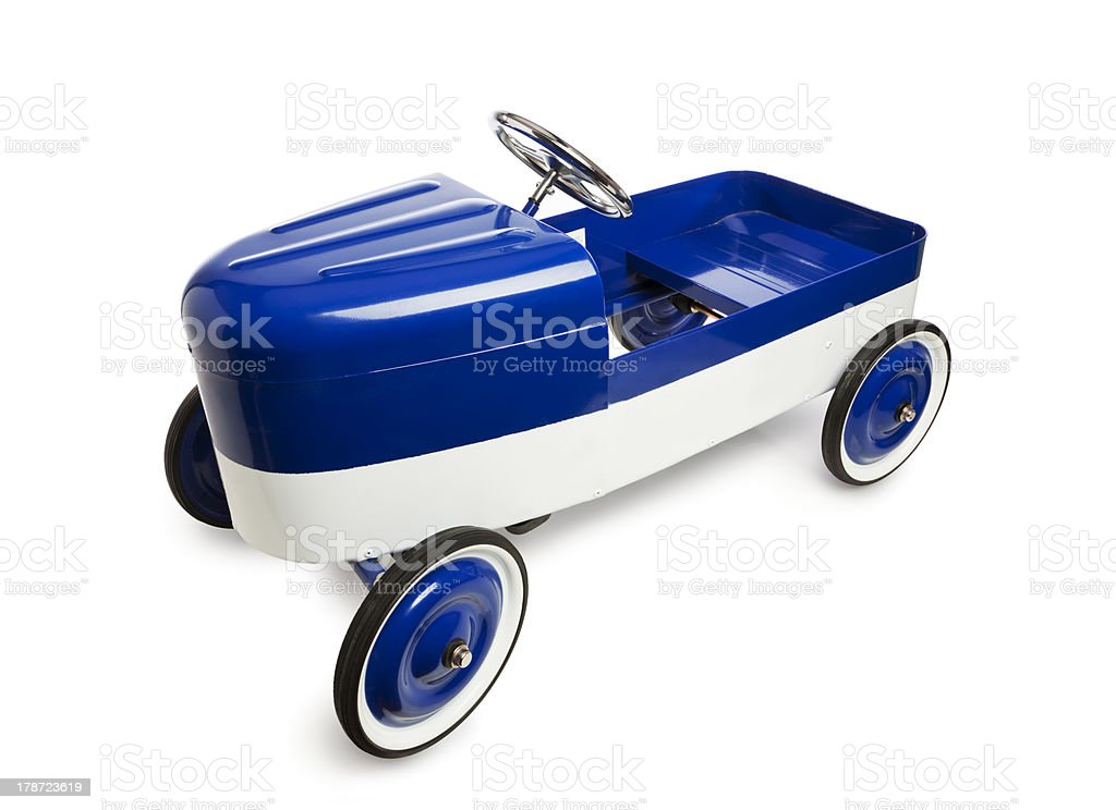 Vintage pedal car toy isolated on white stock photo