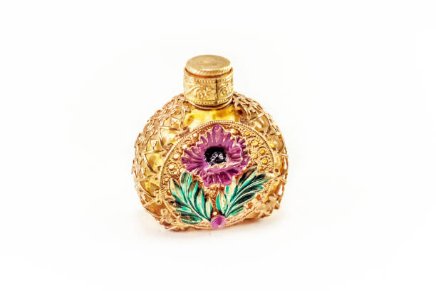vintage perfume bottle in gold filigree - filigree stock photos and pictures