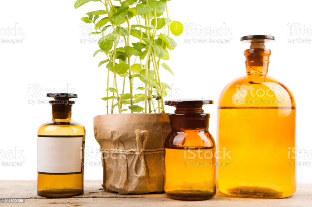 Vintage pharmacy bottles and medical herb isolated on white stock photo