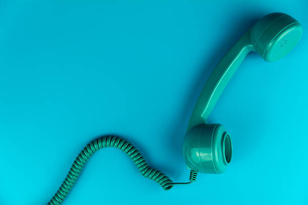 Vintage Phone on a Blue Background - Photo