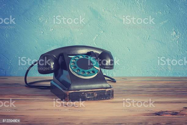 Vintage phone on a wooden table picture id512204924?b=1&k=6&m=512204924&s=612x612&h=gxtmb2fivfeqajfqk3ssguid9ahko7k ueewriu efs=