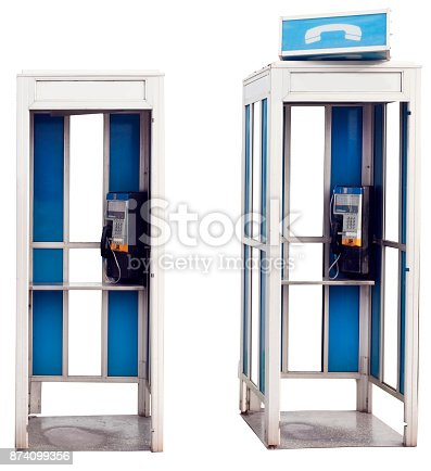 Two isolated blue and white vintage outdoor telephone booths.