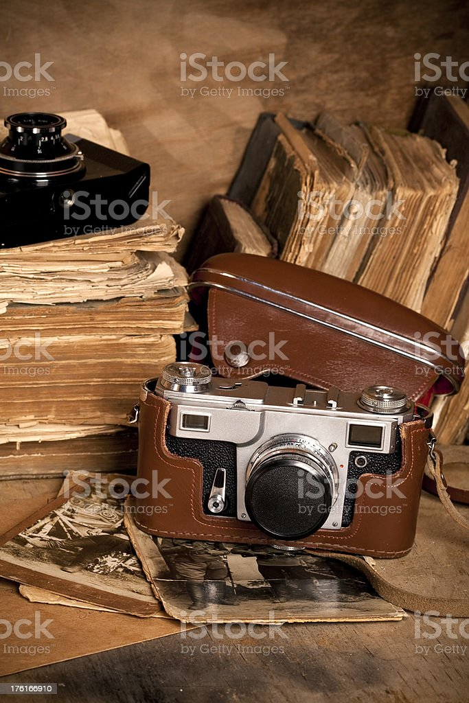 Vintage photo camera and old books royalty-free stock photo