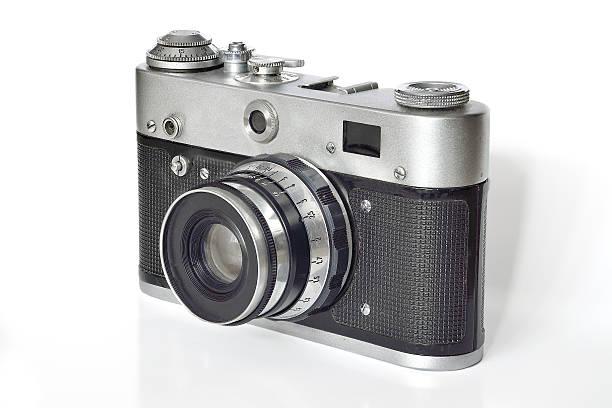 Vintage photo camera on a white background. - Photo