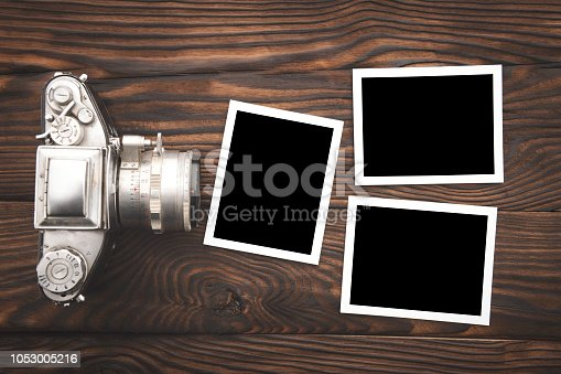 Top View of vintage photo camera on a wooden table with space on text