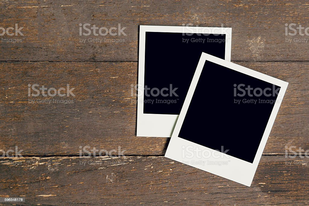 Vintage photo frame blank on old wood background with space royalty-free stock photo