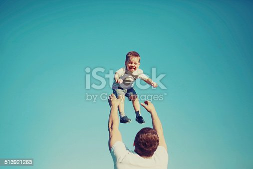 istock Vintage photo happy father and child having fun outdoors 513921263