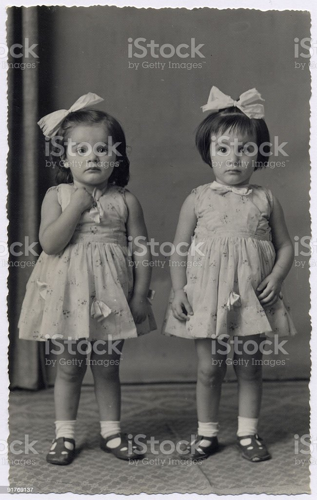 Vintage photo - little twin sisters stock photo