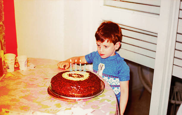 Vintage photo of a boy with his birthday cake stock photo