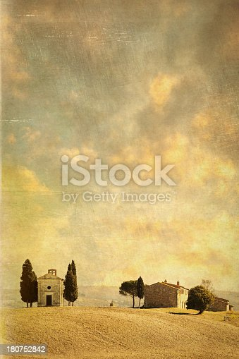 The famous chapel in Tuscany (Cappella di Vitaleta), Location: Val d'Orcia, Tuscany, Italy. Vintage style: toned, added scratches, texture, grain.
