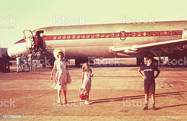 Vintage photo of a family boarding an airplane picture id1072060856?b=1&k=6&m=1072060856&s=612x612&h=l h7pzp6ph g0xflcwaygq1l1lxqrizmu9m4emsnbd0=
