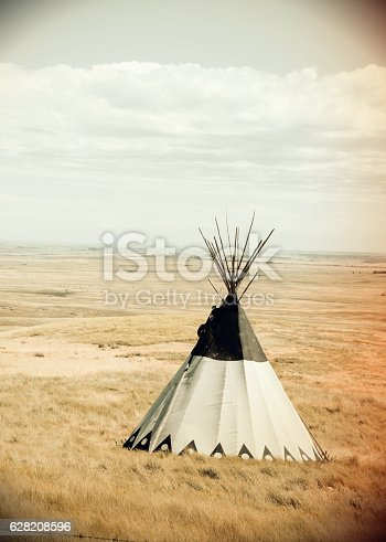 Vintage photo of a single teepee on the grassland prairie