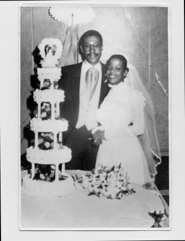 vintage photo of a wedding with all the scratches and wrinkles of the original photo.