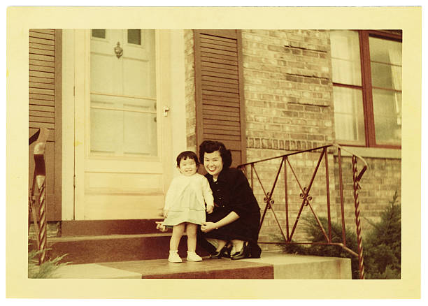 Vintage photo of Asian mother and toddler stock photo