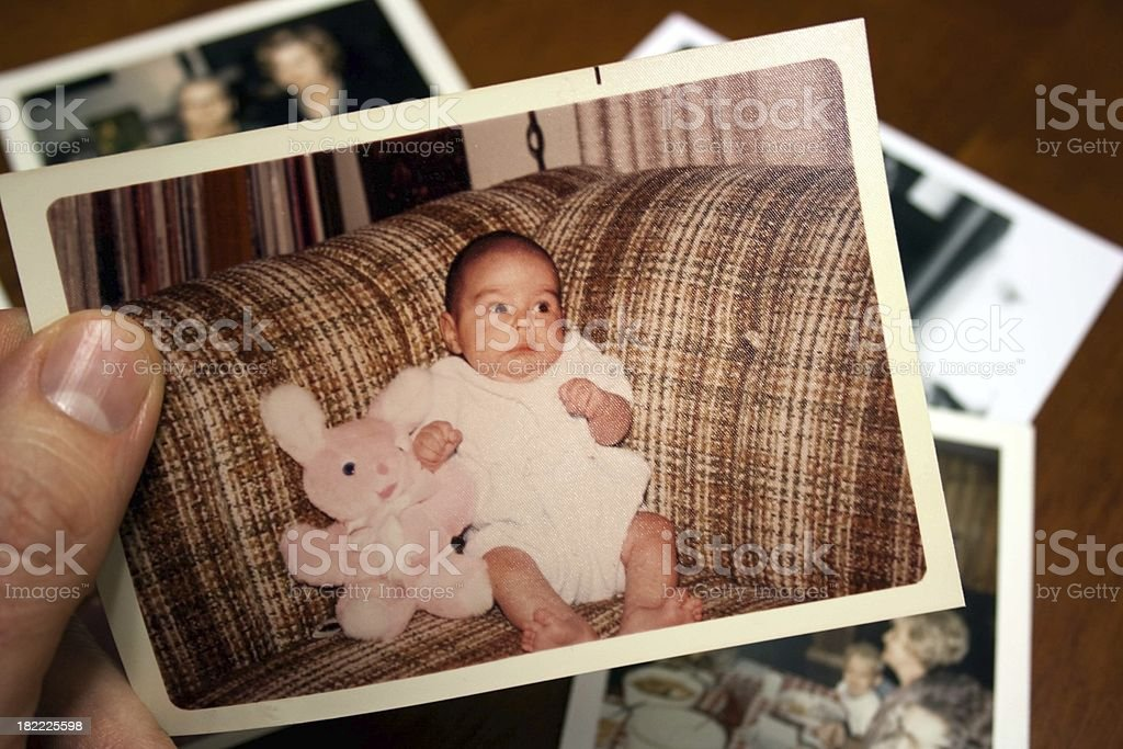 Vintage photo of baby and stuffed toy rabbit stock photo