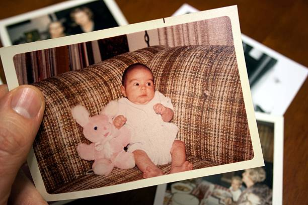 Vintage photo of baby and stuffed toy rabbit Vintage photo of baby sitting next to pink stuffed rabbit.  Please view my newborn animal stock pictures, royalty-free photos & images