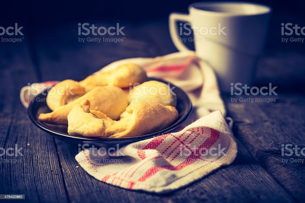 Vintage photo of croissants and cup of tea stock photo