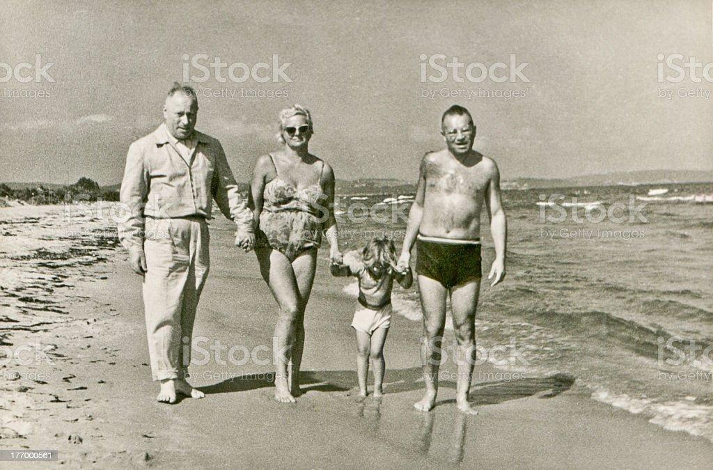 Vintage photo of family on beach royalty-free stock photo