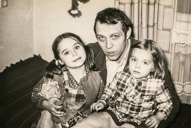 vintage photo of father with daughters - 1980s style stock photos and pictures