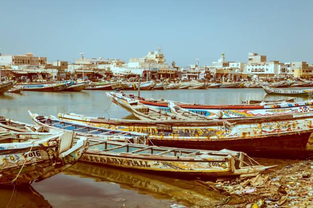 vintage photo of fishing boats parked on the shore in sant louis - st louis стоковые фото и изображения