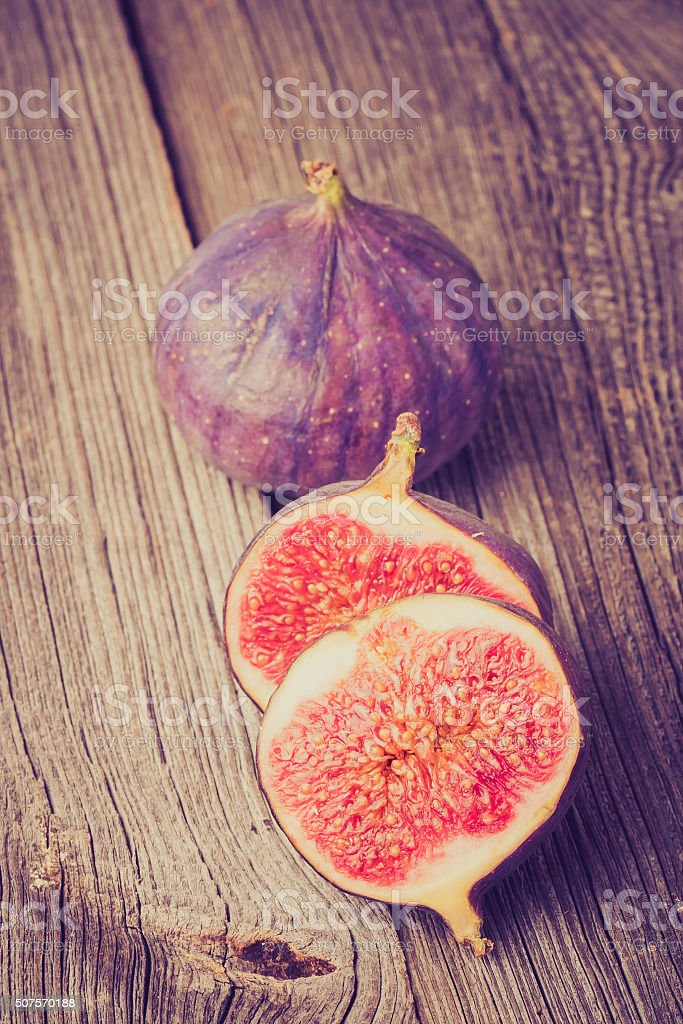 Vintage photo of fresh ripe figs on wooden table stock photo