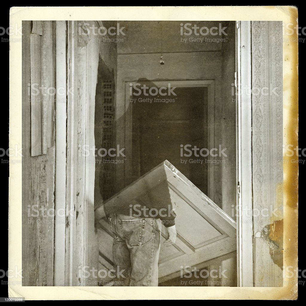 vintage photo of ghost in haunted hallway stock photo