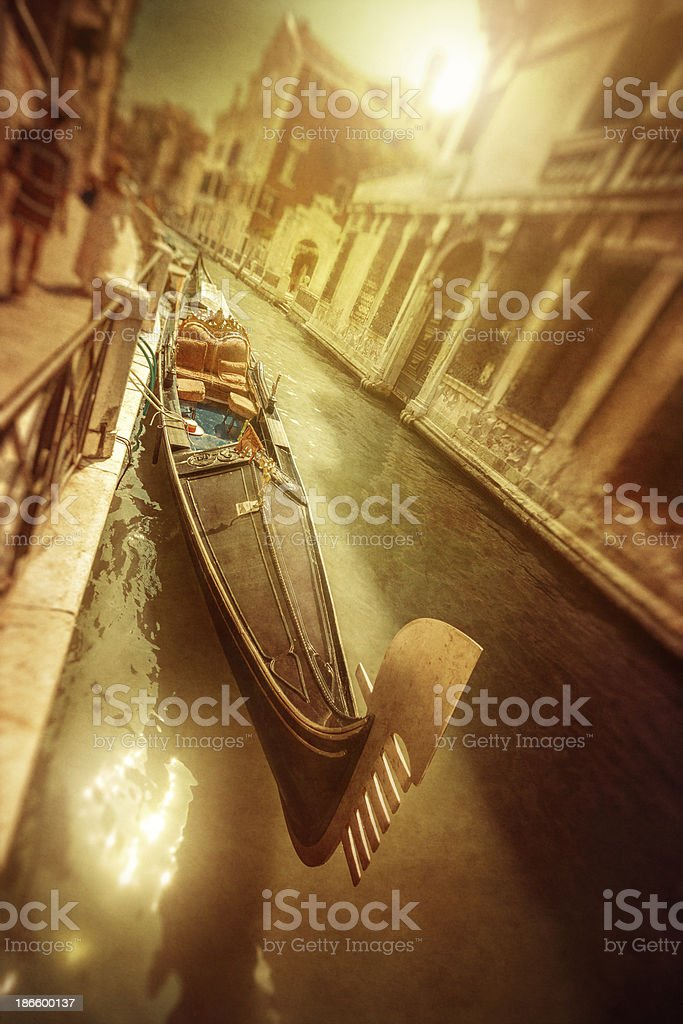 Vintage photo of gondola in venetian canal royalty-free stock photo