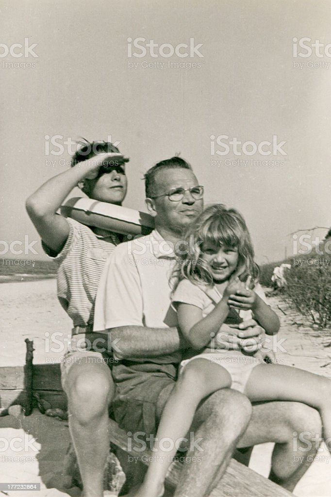 Vintage photo of happy family on beach stock photo