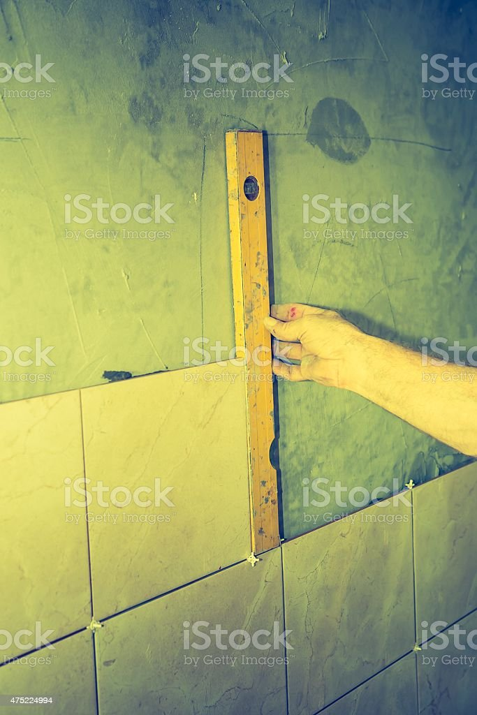 Vintage photo of man hands work with spirit level stock photo