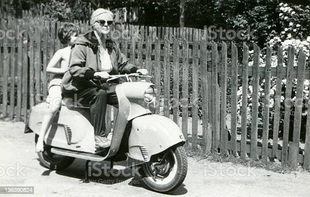 Vintage photo of mother and daughter on scooter picture id136390824?b=1&k=6&m=136390824&s=612x612&h=1cvupttrncqbaab bmzviydbgv3itfcztbc306yoyiy=