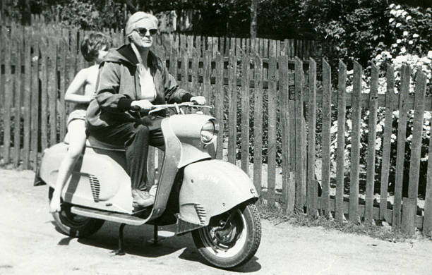 vintage photo of mother and daughter on scooter - 1950s style stock photos and pictures