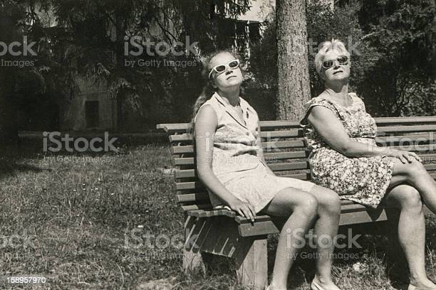 Vintage photo of mother and daughter sunbathing picture id158957970?b=1&k=6&m=158957970&s=612x612&h= vehzygwbtdw6hsiaoijexjcvvh3pwaxb9yrvtzqav0=