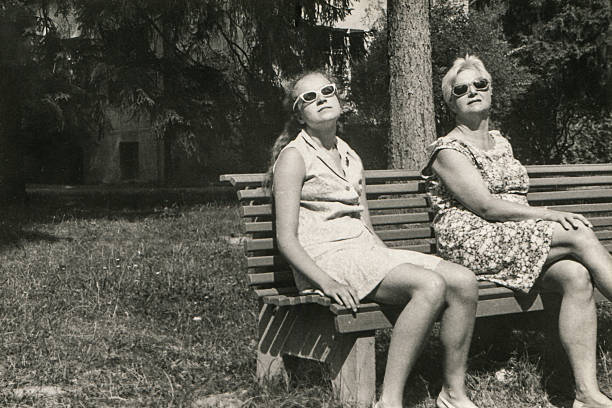 Vintage photo of mother and daughter sunbathing picture id158957970?b=1&k=6&m=158957970&s=612x612&w=0&h=egncu0vbpqcpbbiyhnhqekc5i4lsnzp4t3xtctoyeac=