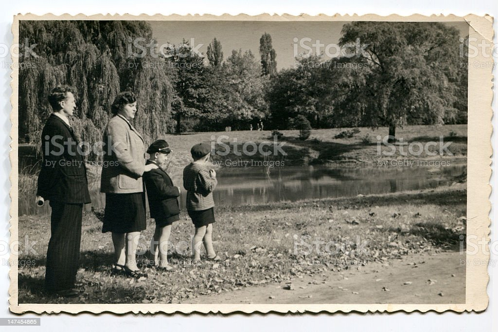 Vintage photo of parents with sons in park stock photo