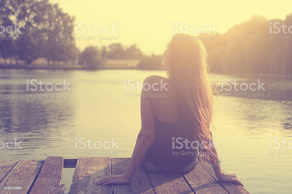 Vintage photo of relaxing young woman in nature stock photo