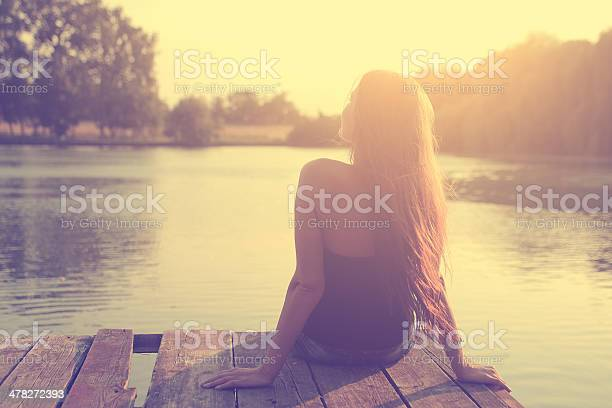 Vintage Photo Of Relaxing Young Woman In Nature Stock Photo - Download Image Now