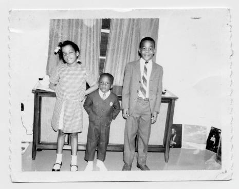 vintage photo of siblings all dressed up.