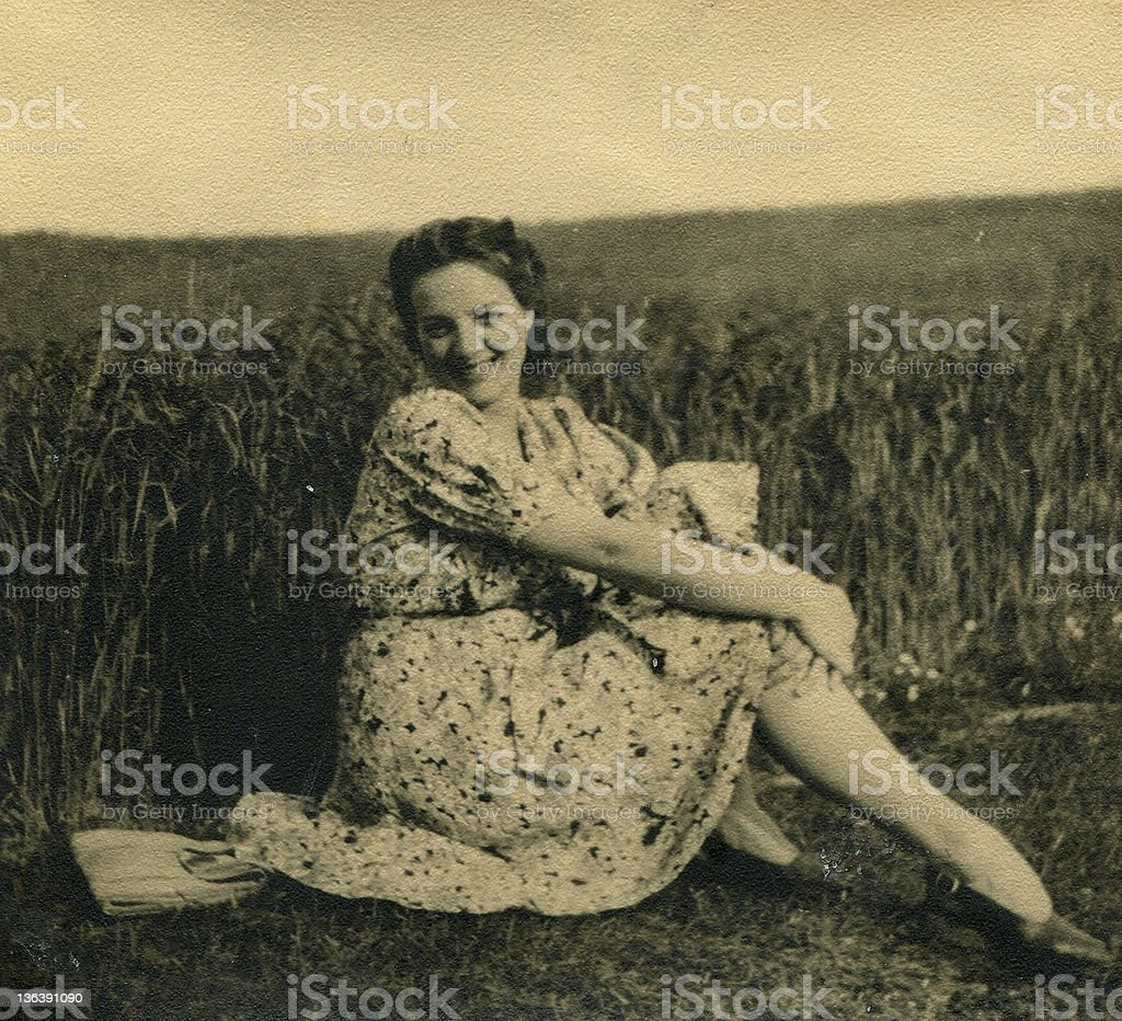 Vintage photo of woman on field royalty-free stock photo