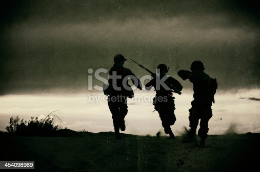 Three WWII Soldiers Defending Their Position.  Guns and Bayonetts out and ready.  This image has a
