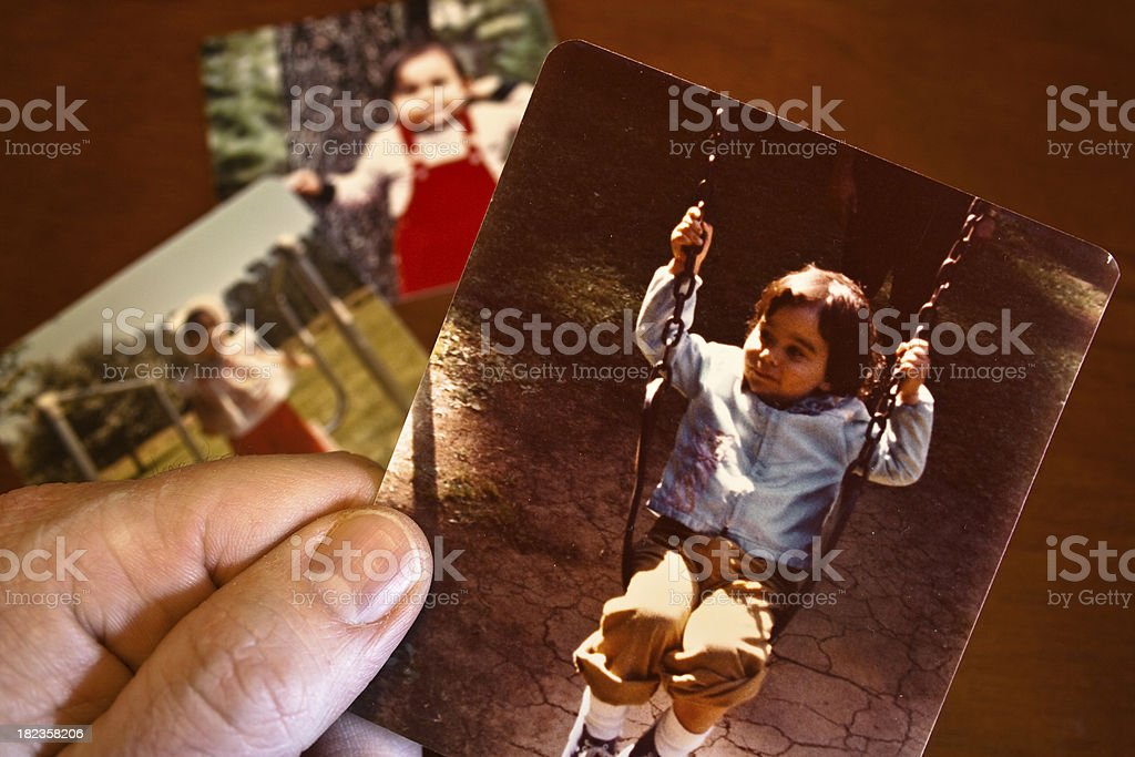 Vintage photo of young girl on a swing stock photo