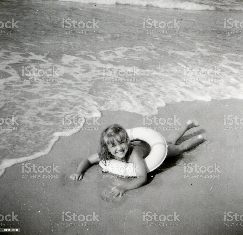Vintage photo of young girl on beach stock photo