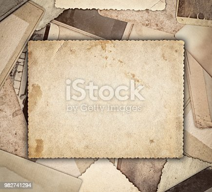 istock Vintage photo on heap old photos background 982741294