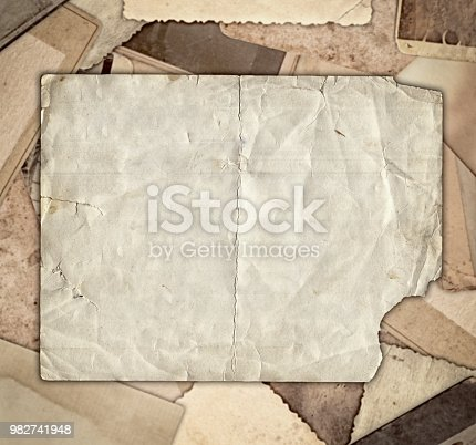 istock Vintage photo on heap old photos background 982741948