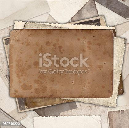 istock Vintage photo paper on heap of old photos 982746220