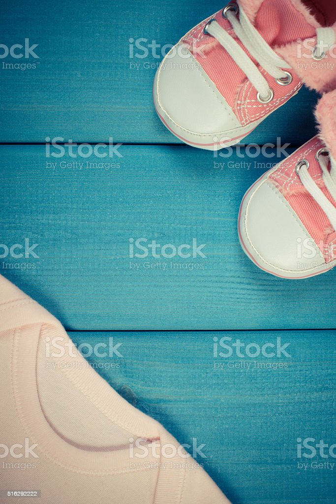 Vintage photo, Shoes and bodysuits for newborn, expecting for baby stock photo