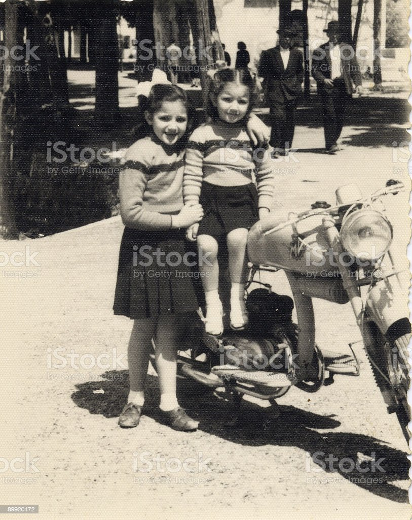 Vintage photo - sisters with motorcycle stock photo