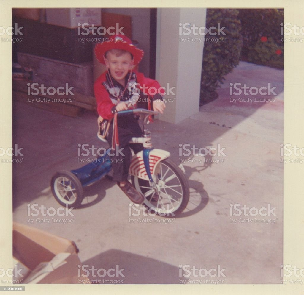 Vintage Photograph of a young boy in a cowboy outfit stock photo