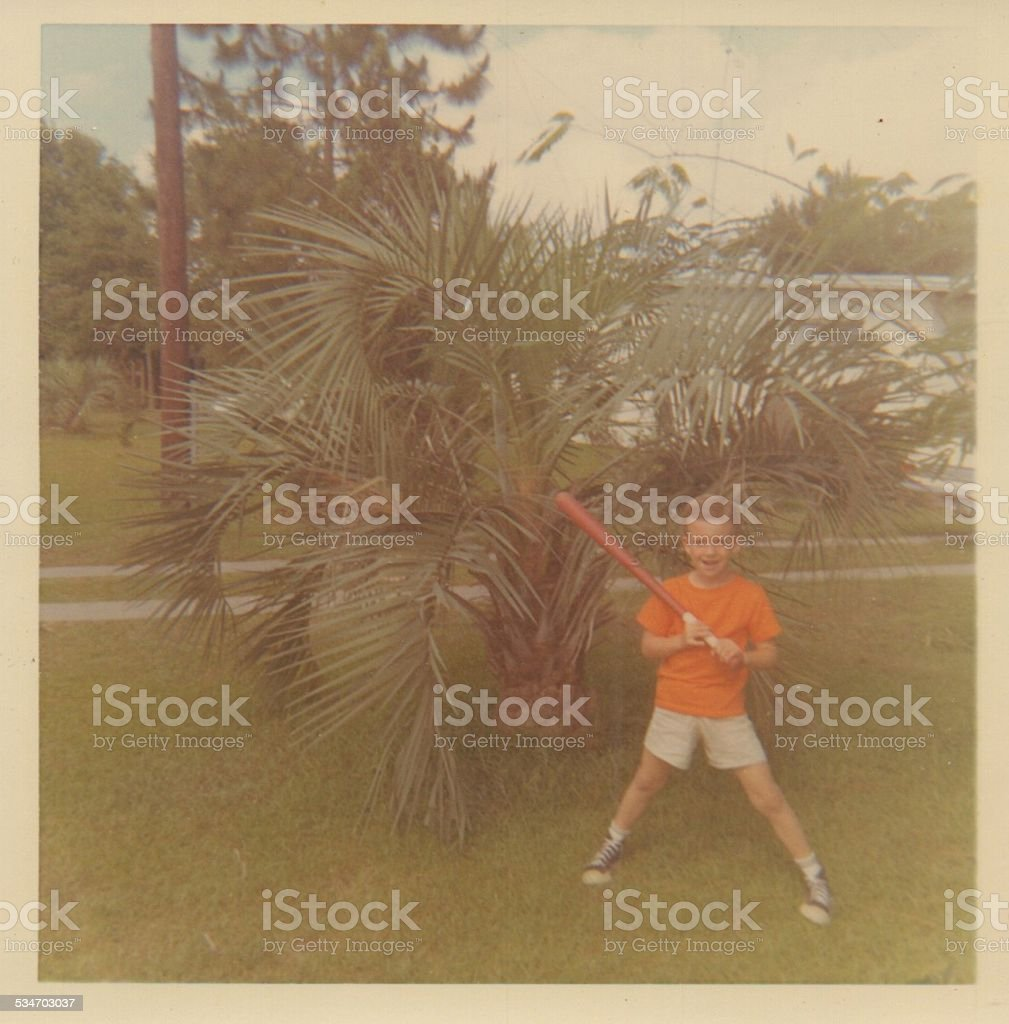 Vintage Photograph of a young boy with a baseball bat stock photo