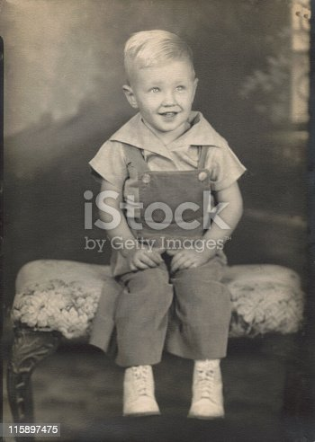 Studio vintage, antique portrait of a two-year-old boy. Photo taken in 1944.